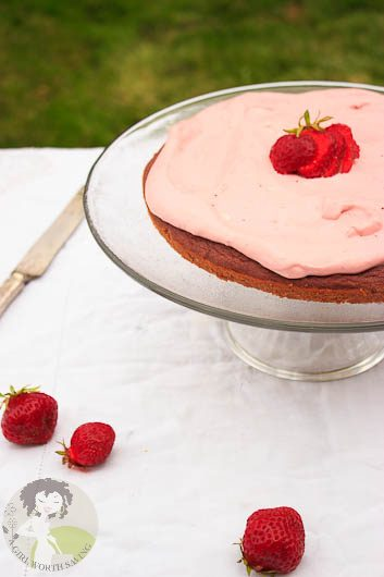 Strawberry Coconut Flour cake on a cake stand outdoors