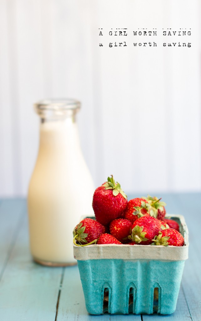 Fresh milk and fresh strawberries on a table to make homemade Strawberry Milk