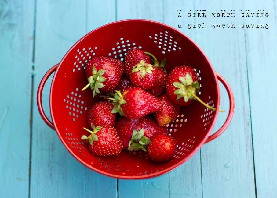 fresh strawberries in a strainer for this Strawberry Milk recipe