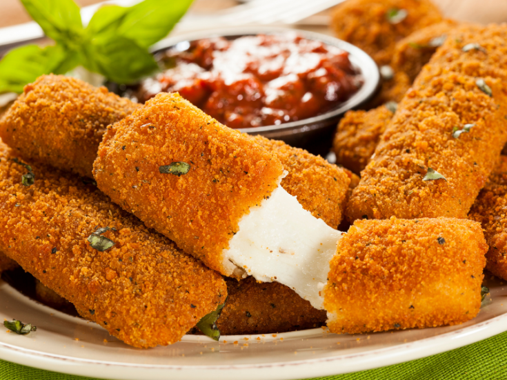 homemade gluten free mozzarella sticks with cheese oozing out
