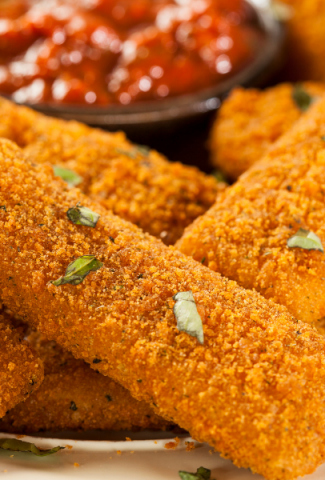 Gluten free Mozzarella Sticks with dip in the background