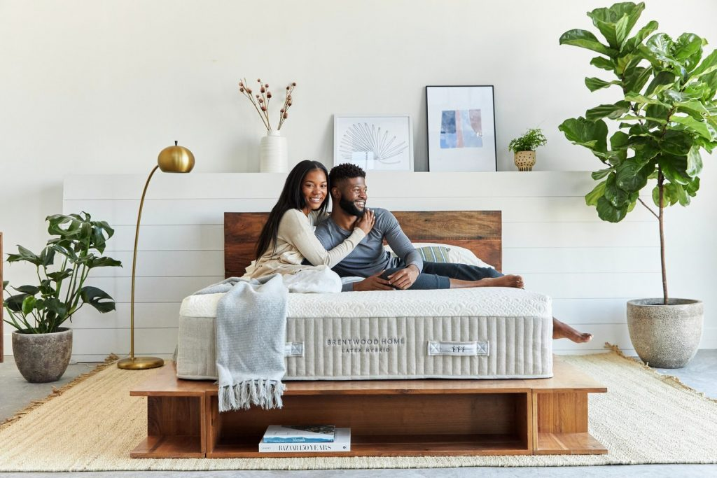 Brentwood Home Mattress with a couple on top of it resting