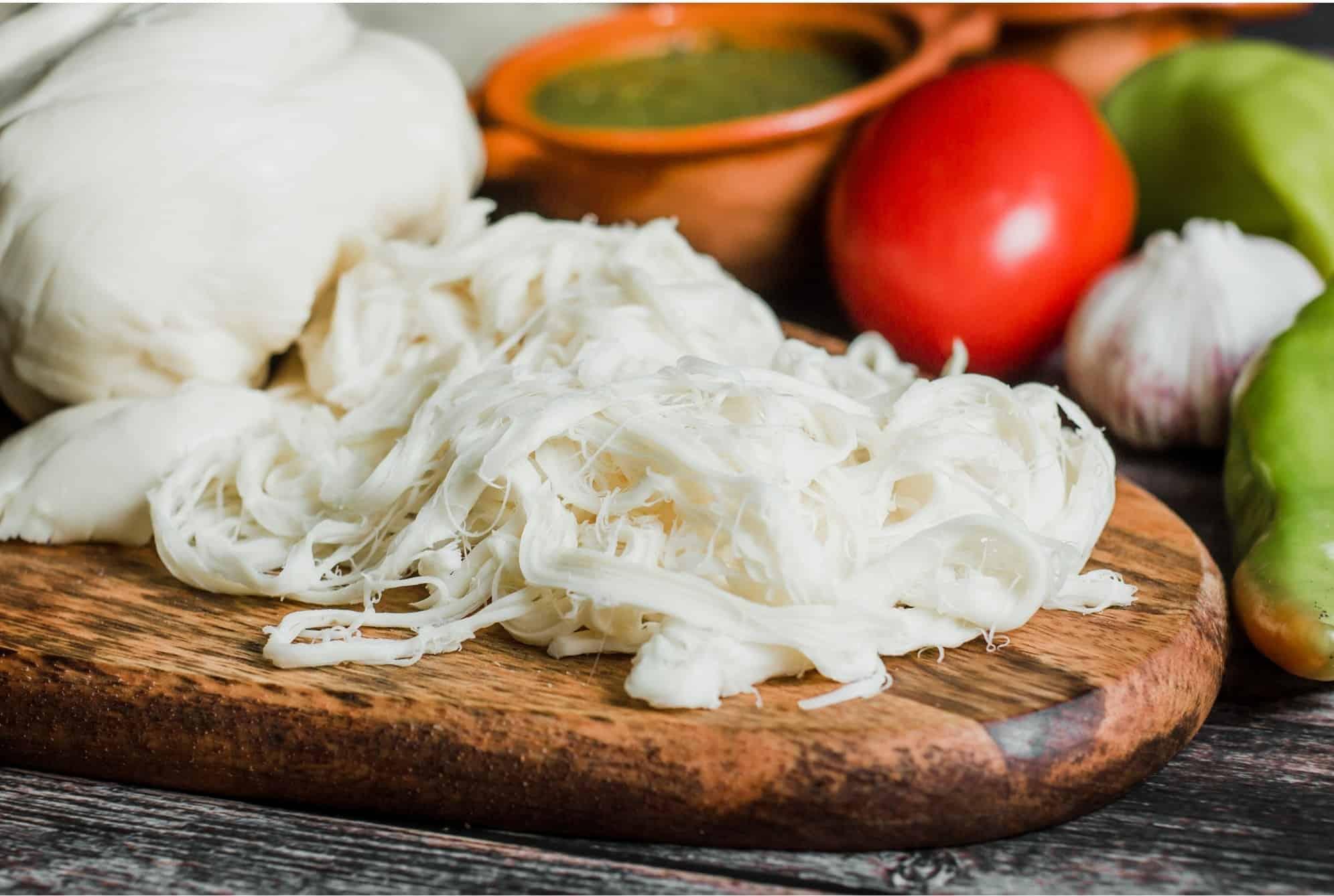 oaxaca cheese freshly made on a cutting board