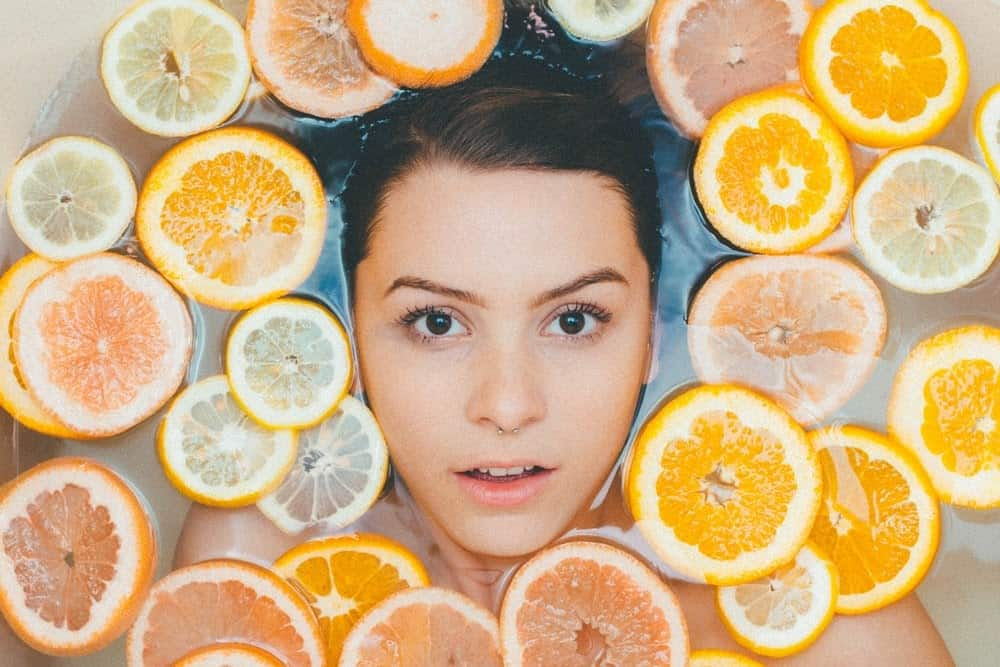 woman in bath with orange slices