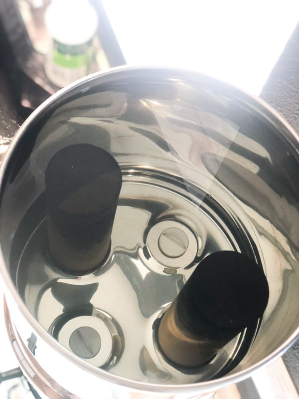 Showing inside of the top chamber of a Royal Berkey Water filter with two black filters.