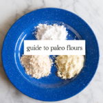 Learning to bake with paleo flours like almond flour, coconut flour and tapioca flour can be intimidating. Have no fear, this paleo flour guide will help you figure out how replicate your favorite baked goods like breads, cakes and more.