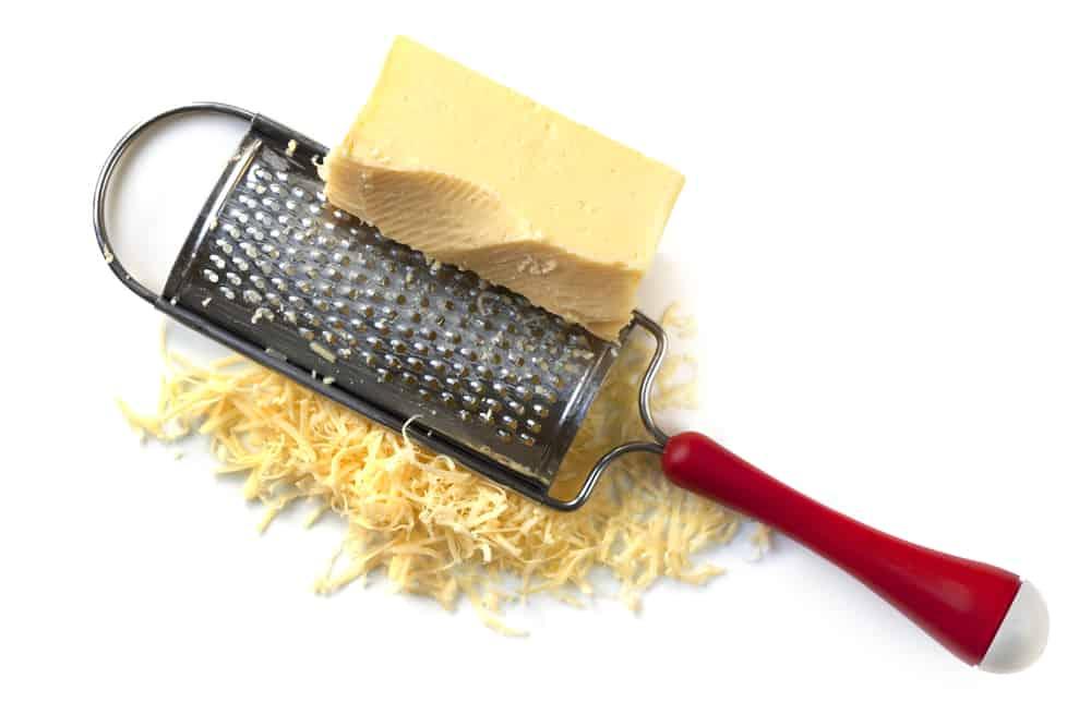 shredding cheese for macaroni and cheese
