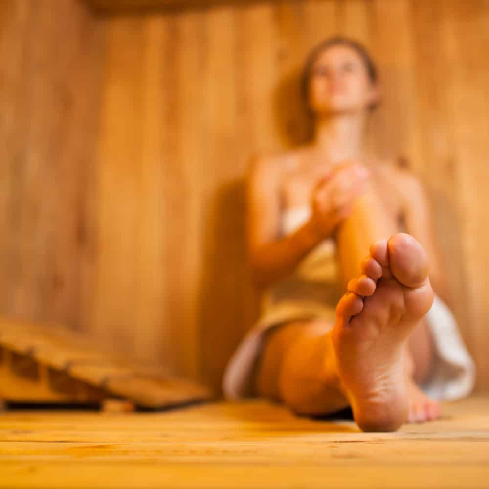 Young woman relaxing in a infrared sauna