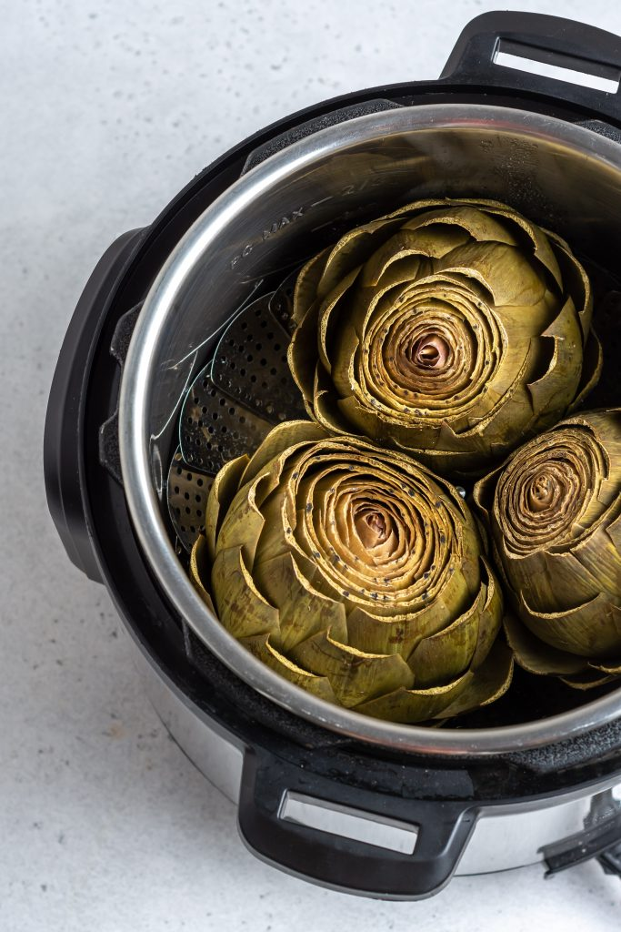 Are you sick of your stovetop taking forever to cook artichokes? Make instant pot artichokes in a fraction of the time using this super simple recipe! Check it!