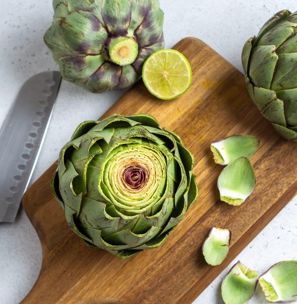 cut artichokes on a cutting board