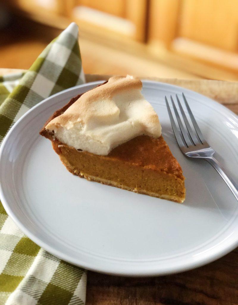 Slice of sweet potato pumpkin pie on a plate