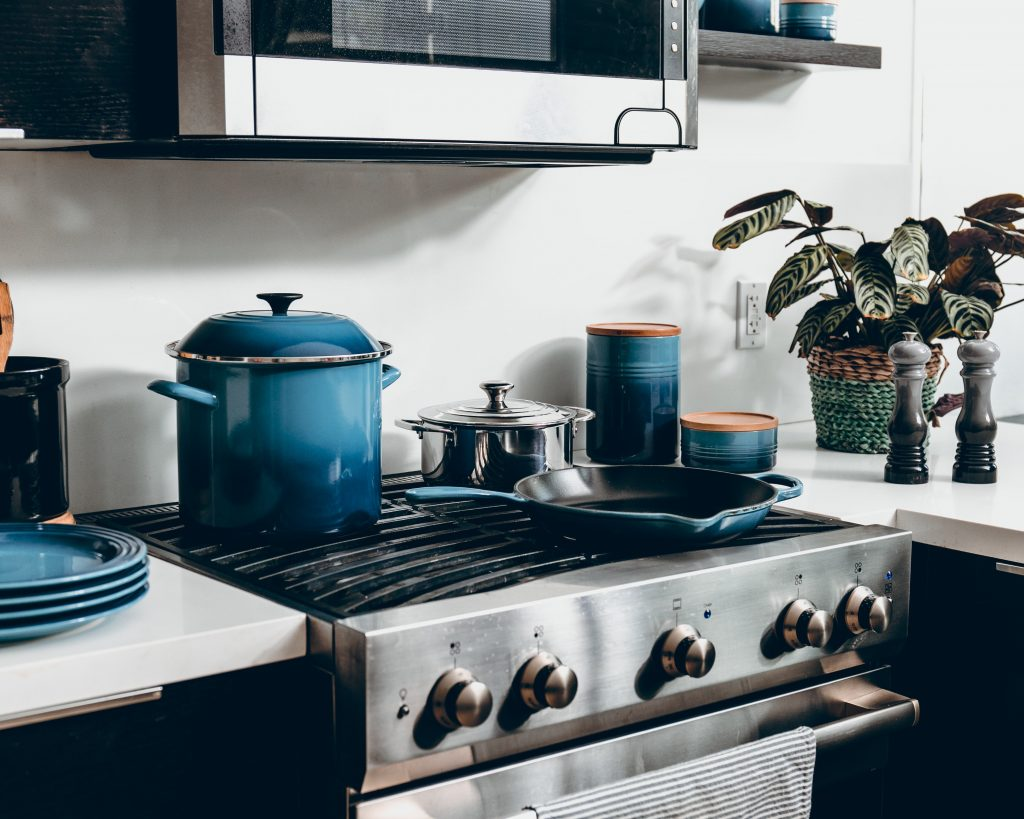 Different cast iron pans on a stove in this best non toxic cookware review